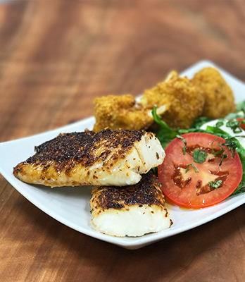 Harissa-Crusted Haddock with Turmeric-Fried Cauliflower and Caprese Salad